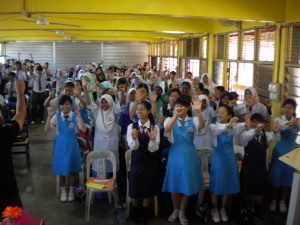 Students of SMK Tun Mutahir were performing light aerobic exercises