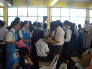 Students of SMK Tun Mutahir during activities with Kolej Sinar
