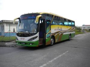 Bus was waiting for tourist guide students for Melaka Tour in front of Sinar College Melaka Raya